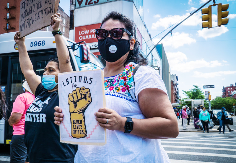 Members of the Latino community at a Black Lives Matter protest in New York City on June 14, 2020.