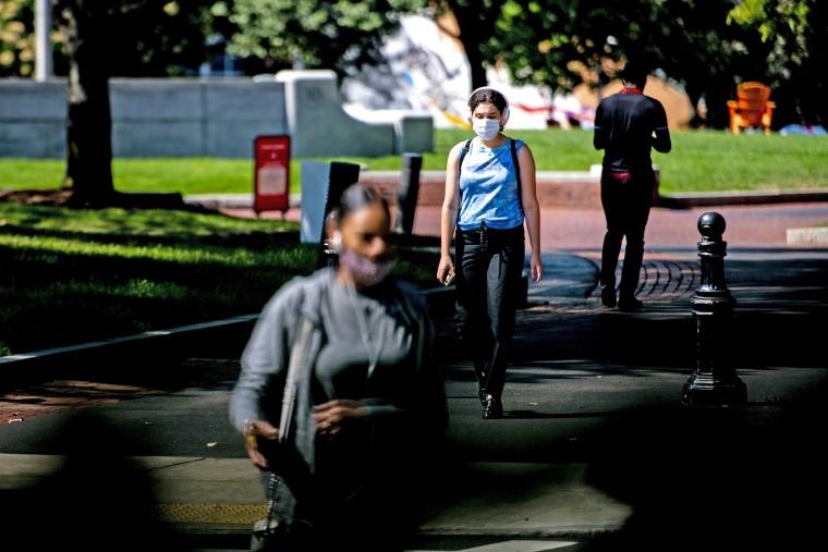 Students walk through Centennial Common at Northeastern University in Boston on Aug. 24, 2020.