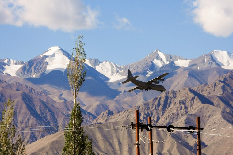 Image: An Indian Air Force Hercules military transport plane prepares to land at an airbase in Leh, the joint capital of the union territory of Ladakh bordering China