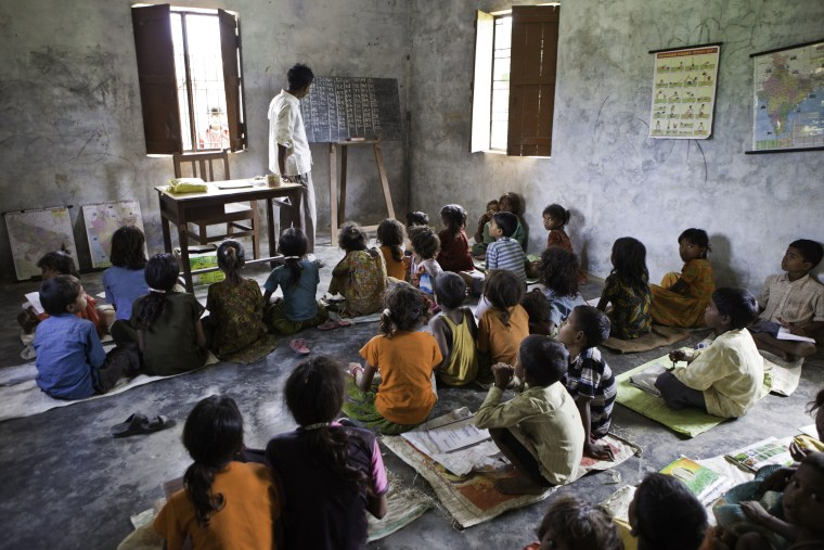 Image: Children from a Dalit community take part in education classes in the Maharjganj district in India.