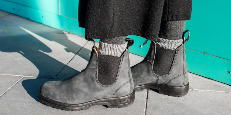 woman wearing ankle boots outside