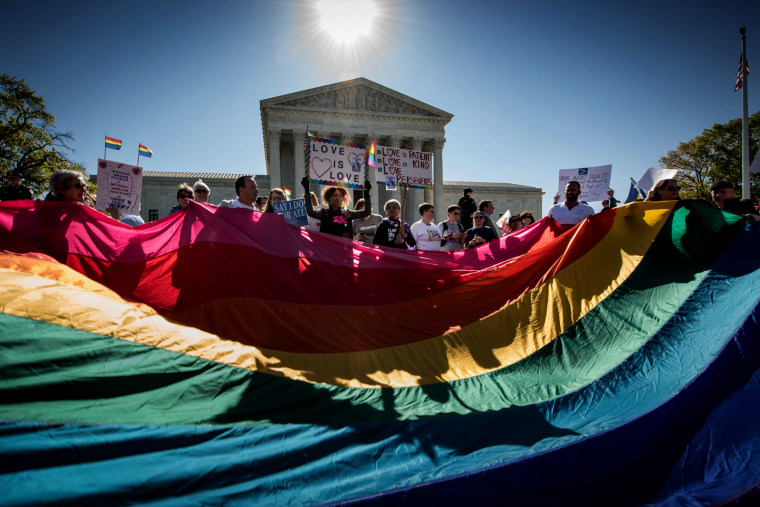 Image: People rally outside of the Supreme Court during arguments on same-sex marriage on April 28, 2015.