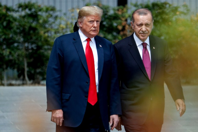 Image: President Donald Trump and Turkish President Recep Tayyip Erdogan at the opening ceremony of the NATO Summit in Brussels on July 11, 2018.