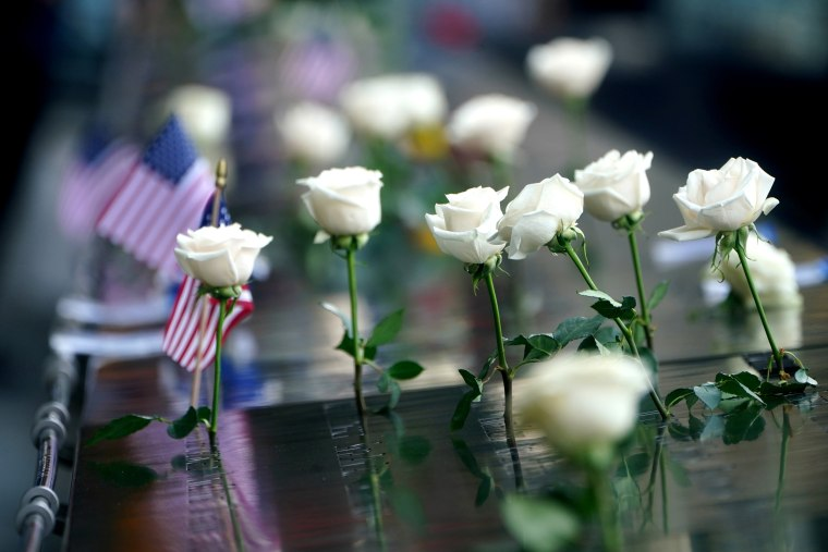 Image: Flowers left on names at North pool of 911 Memorial