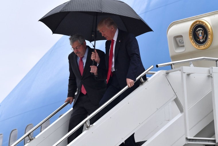 Image: President Donald Trump and U.S. Ambassador to China Terry Branstad arrive at Eastern Iowa Airport