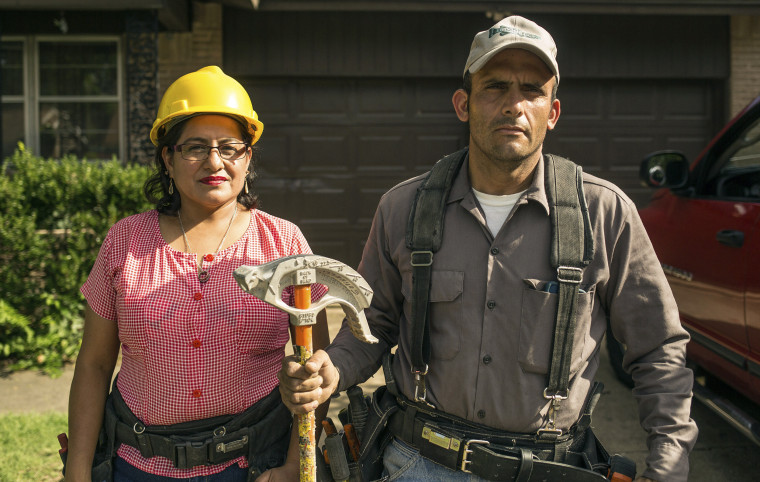 """Salvadoran immigrants Claudia and Alex Golinelli, featured in """"Building the American Dream,"""" stand outside their Dallas home."""