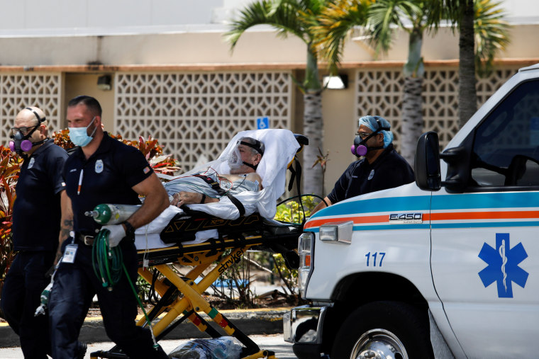 Image: FILE PHOTO: Emergency Medical Technicians (EMT) leave with a patient at Hialeah Hospital where coronavirus disease (COVID-19) patients are treated