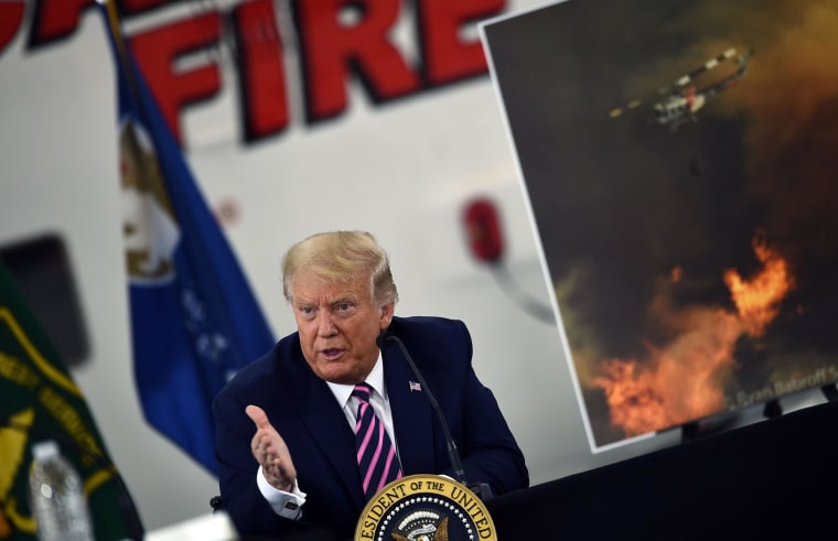 Image: President Donald Trump speaks during a briefing on wildfires with local and federal fire and emergency officials at Sacramento McClellan Airport in McClellan Park, CA