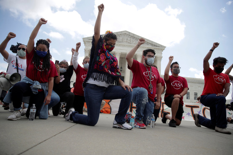 Image: People take knee in support of Black Live Matter movement outside the U.S. Supreme Court in Washington