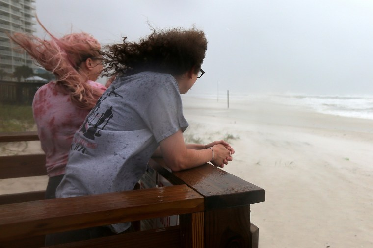 Image: Jordan Spence and Dawson Stallworth watch waves come ashore as Hurricane Sally approaches in Orange Beach