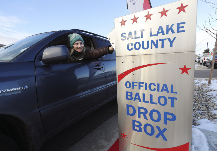 Image: Leslie Tate drops off her ballot in Cottonwood Heights, during the Super Tuesday primary vote in Salt Lake City.