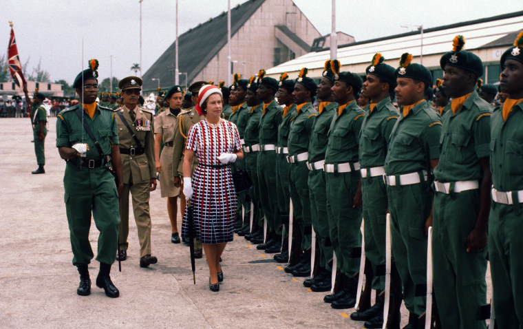 Image: Queen Elizabeth ll inspects a guard of honour as she arrives in Barbados on Oct. 31, 1977 in Barbados.