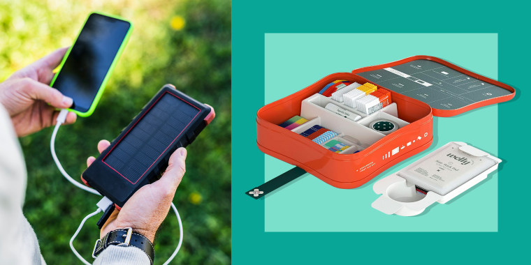 man with portable phone charger and first aid kit. Prepare for hurricanes and tropical storms with a checklist of items like a portable generator, first aid kit, routers, hand sanitizer, board games, flashlights and more.
