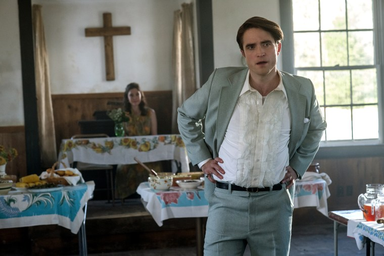 "Robert Pattinson as Preston Teagardin in ""The Devil All The Time"" on Netflix."
