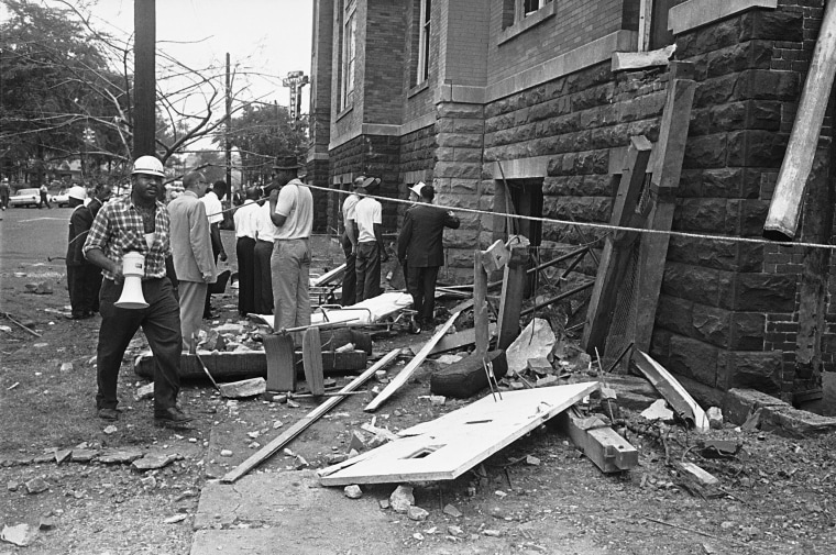 Investigators work outside 16th Street Baptist Church in Birmingham, Ala., following an explosion that killed four young girls on Sept. 15, 1963.