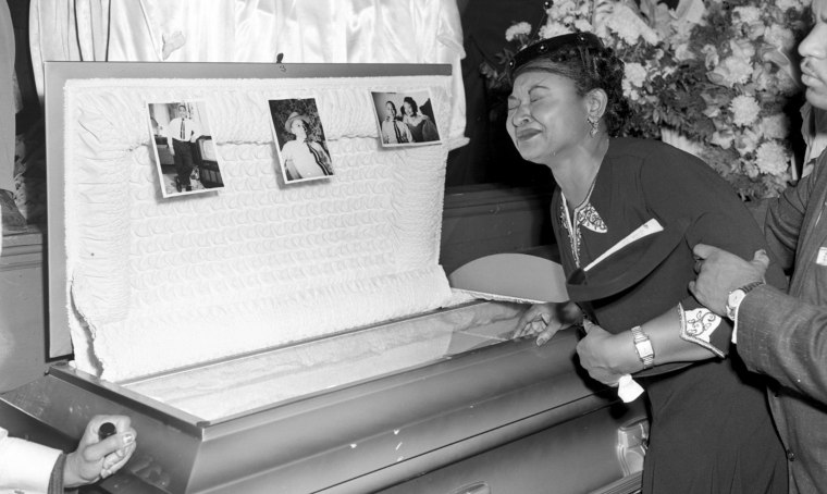 Mamie Till Mobley weeps at the funeral for her son, Emmett Till, on Sept. 6, 1955, in Chicago.