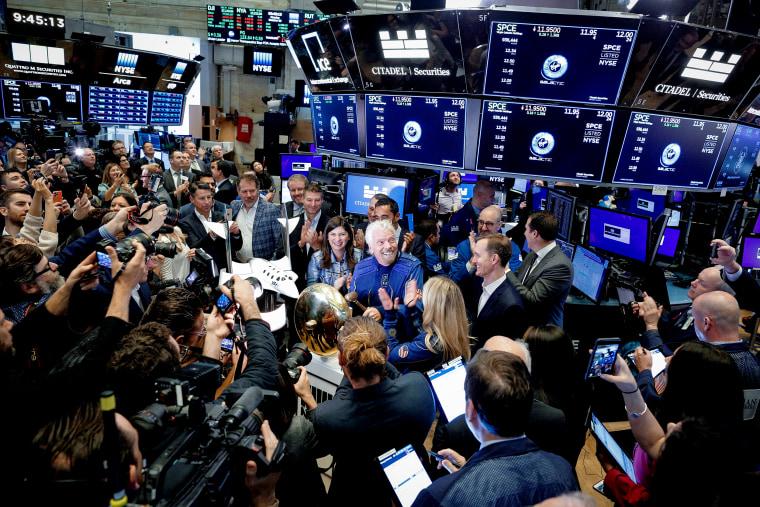 Sir Richard Branson rings bell on floor of New York Stock Exchange as Virgin Galactic (SPCE) begins public trading in New York