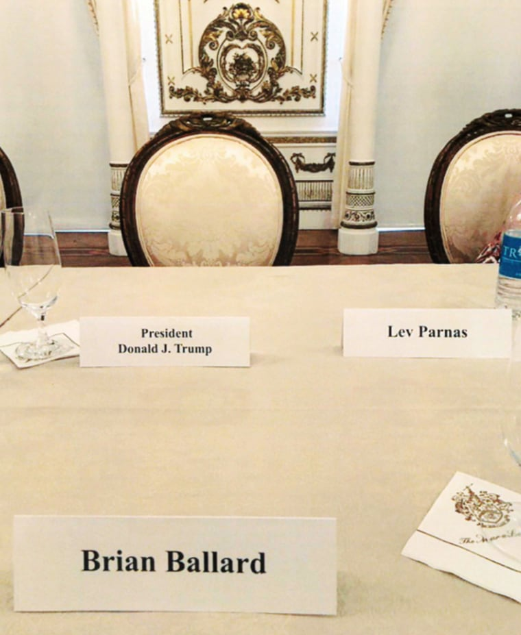 A table setting with Donald Trump, Brian Ballard and Lev Parnas seated close together for a Republican fundraising dinner at Mar-a-Lago in Palm Beach, Fla. on April 20, 2018.