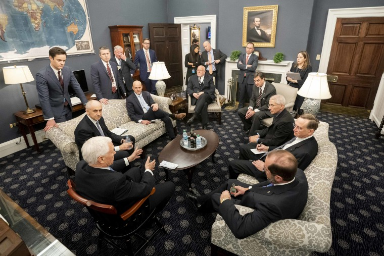 Olivia Troye, background top right, listens while Vice President Mike Pence meets with the President's coronavirus taskforce on Feb. 26, 2020, in his West Wing Office of the White House.