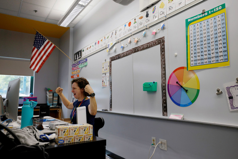 Image: Teacher Jessica Crane greets her first grade students virtually from her classroom at the Kelly Elementary School on the first day of the new school year in a city hard hit by the coronavirus disease (COVID-19) outbreak, in Chelsea, Massachusetts