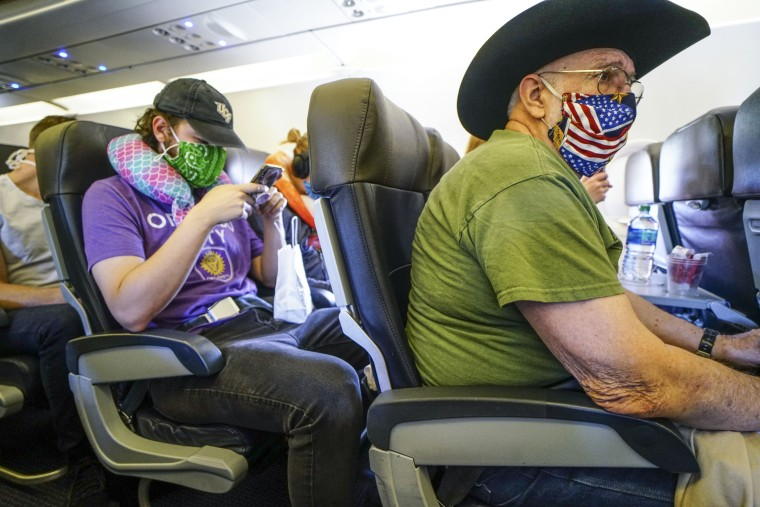Image: Passengers onboard an American Airlines flight