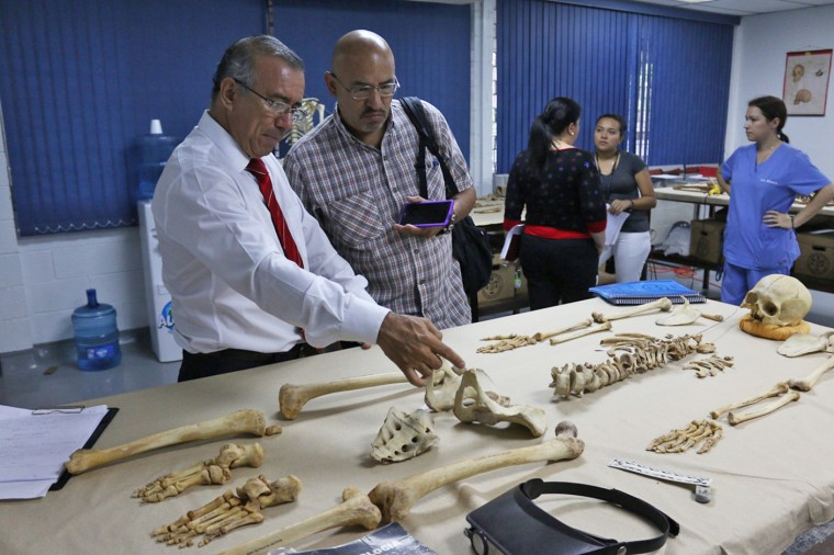Roberto Lovato, center, at El Salvador's only forensics lab, in 2015.
