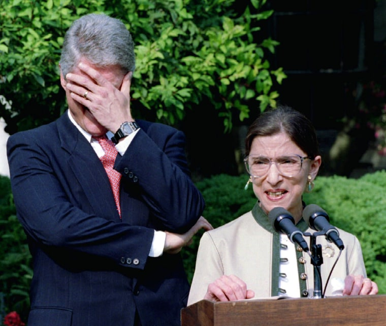 Image: President Clinton laughs at a remark made by Ruth Bader Ginsburg, who is on her way to the US Suprem..