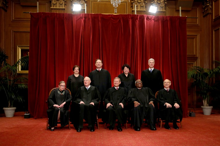 Image: Roberts leads the U.S. Supreme Court in taking a new family photo including Gorsuch, their most recent addition, at the Supreme Court building in Washington