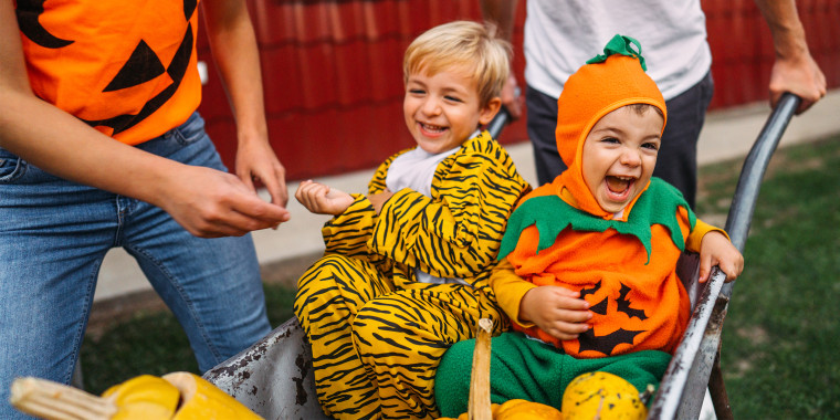 children having fun outside in halloween costumes