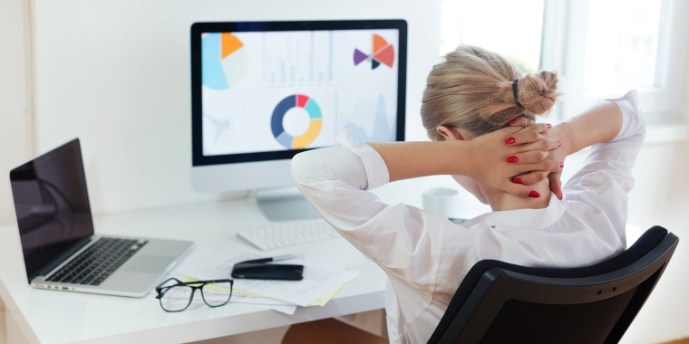 woman with bad posture and neck strain sitting in home office