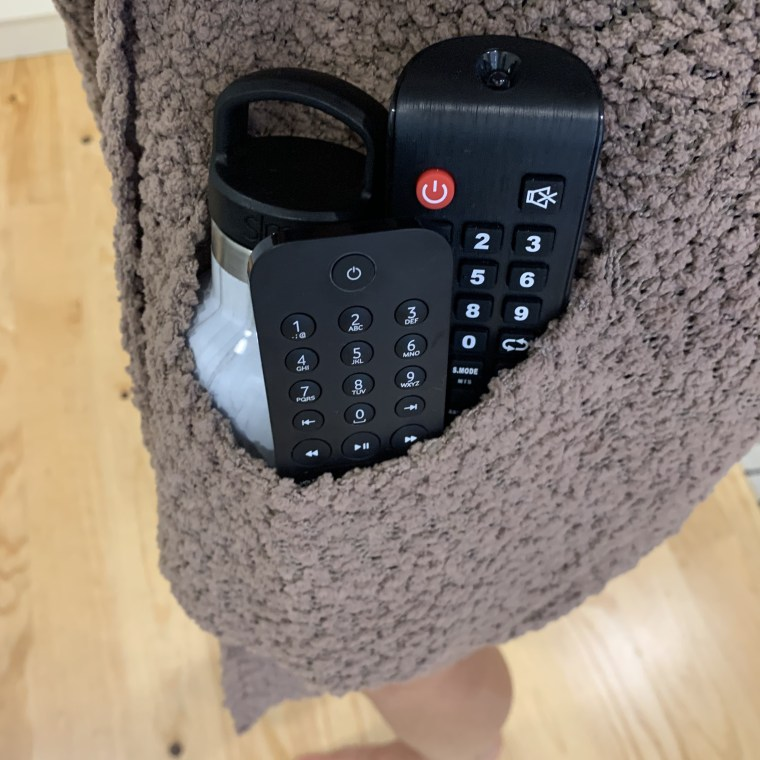 the sweater pocket can fit two remotes, my water bottle and more