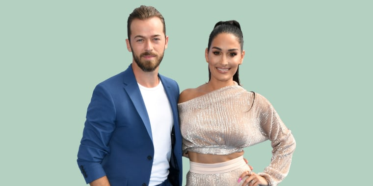"Nikki Bella opened up about her postpartum love life with fiancé Artem Chigvintsev in a recent episode of ""The Bellas Podcast."" Bella and Chigvintsev welcomed their first child on July 31."