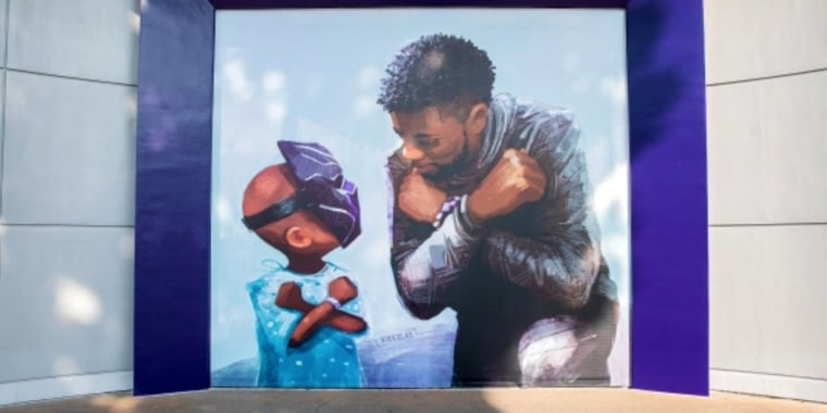 "The artwork from Nikkolas Smith shows the late Marvel star giving the Wakanda salute to a young fan wearing a ""Black Panther"" mask."