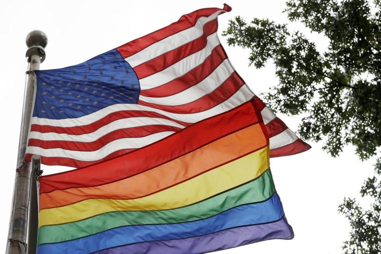 Image: The rainbow flag flies beneath the American flag