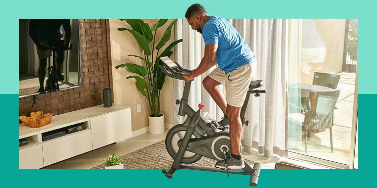man using exercise bike in living room