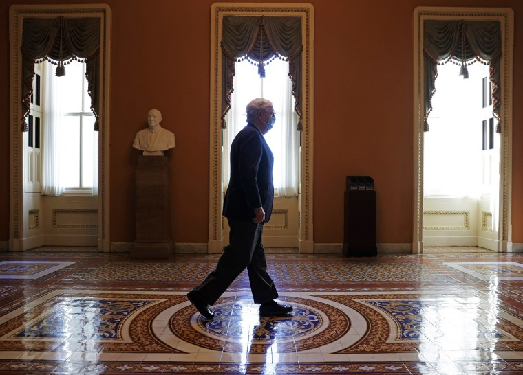 Senate Majority Leader Sen. Mitch McConnell walks at the Capitol on Sept. 21, 2020.