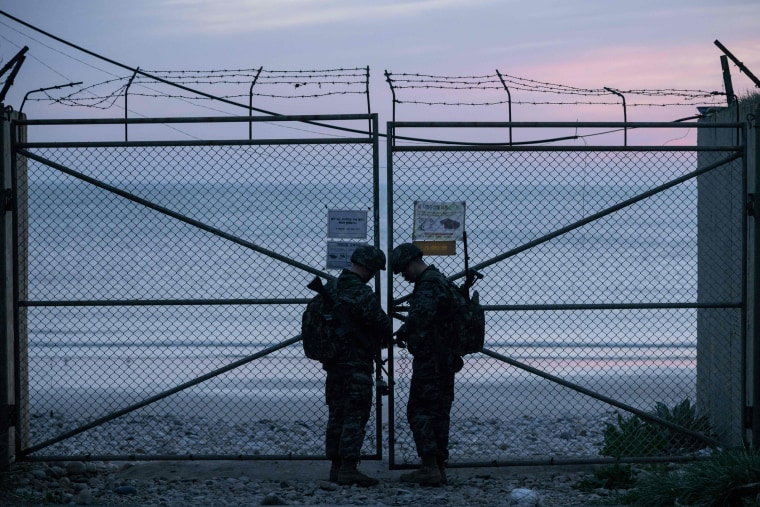 Image: South Korean soldiers lock the entrance to a beach on Yeonpyeong island, near the 'northern limit line' sea boundary with North Korea.