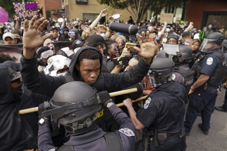 Image: Police and protesters converge during a demonstration, Wednesday, Sept. 23, 2020, in Louisville, Ky.