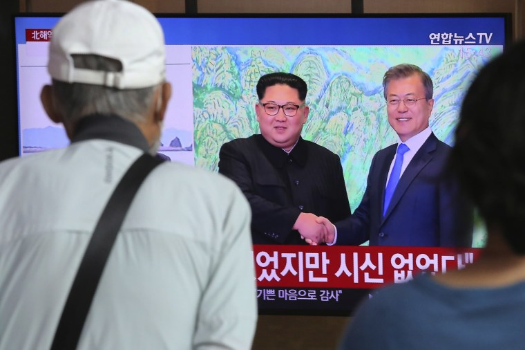 Image: People watch a TV showing a file image of North Korean leader Kim Jong Un, left, and South Korean President Moon Jae-in during a news program at the Seoul Railway Station in Seoul, South Korea