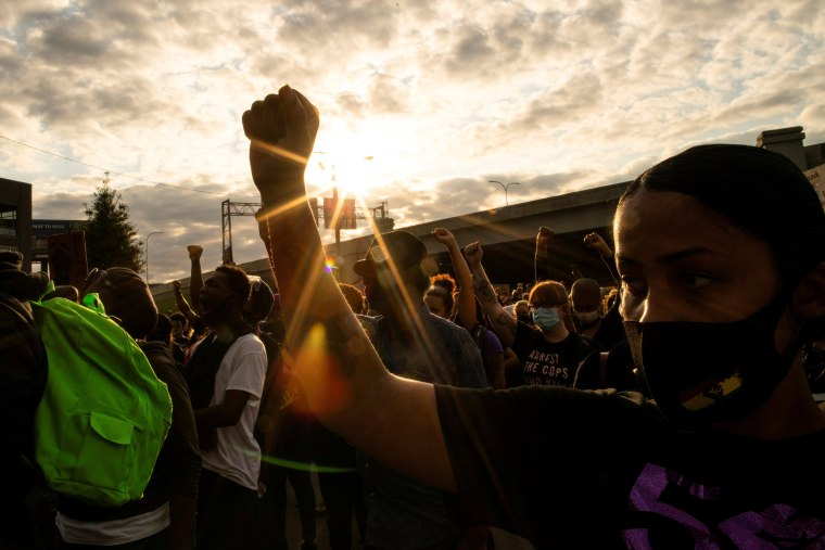 Image: People react after a decision in the criminal case against police officers involved in the death of Breonna Taylor, in Louisville