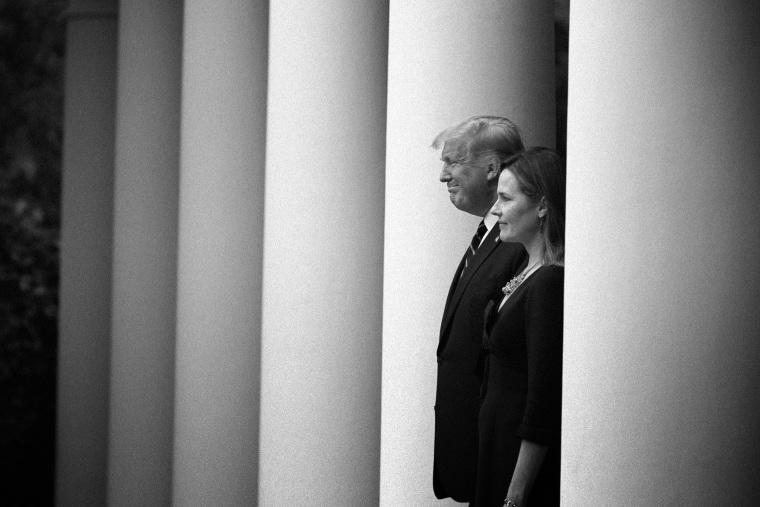 Image: President Donald Trump walks with Judge Amy Coney Barrett where he will announce Barrett as his nominee to the Supreme Court at the White House on Sept. 26, 2020.