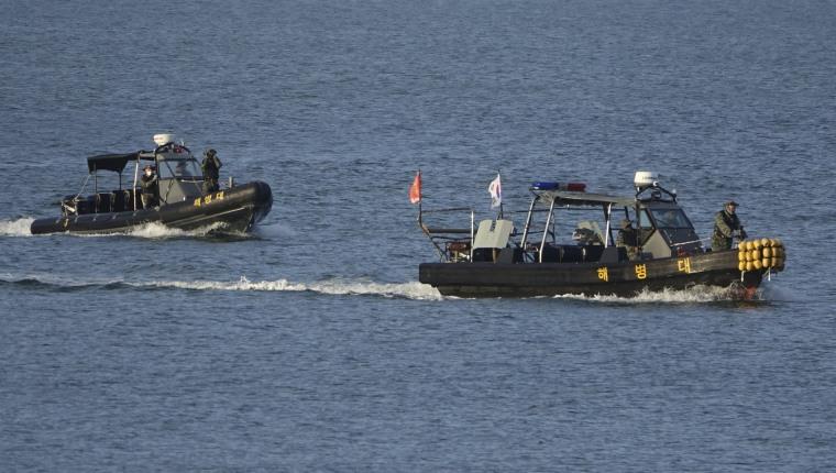 South Korean marine boats patrol near Yeonpyeong island, South Korea on Sunday.