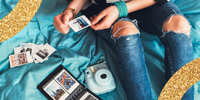 teen girl printing photos from instant camera