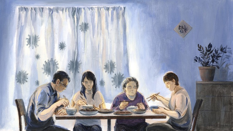 Image: A father, daughter, grandmother and mother eat dinner while coronavirus spores loom in shadow outside of their window.