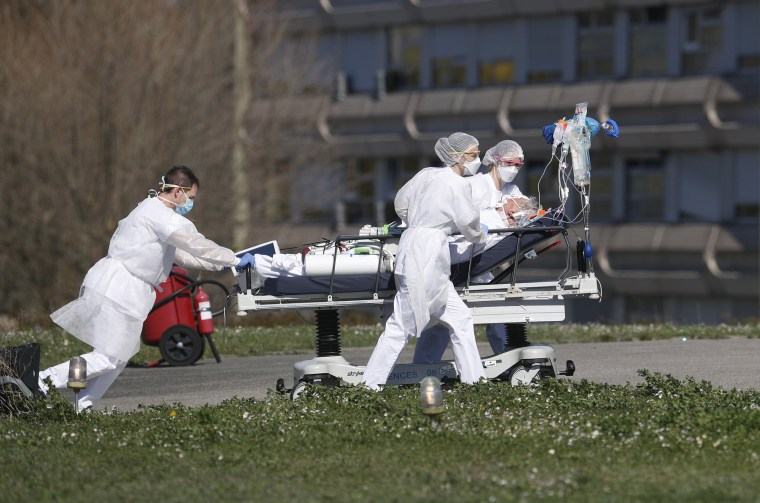 Image: A victim of the Covid-19 virus is evacuated from the Mulhouse civil hospital, eastern France