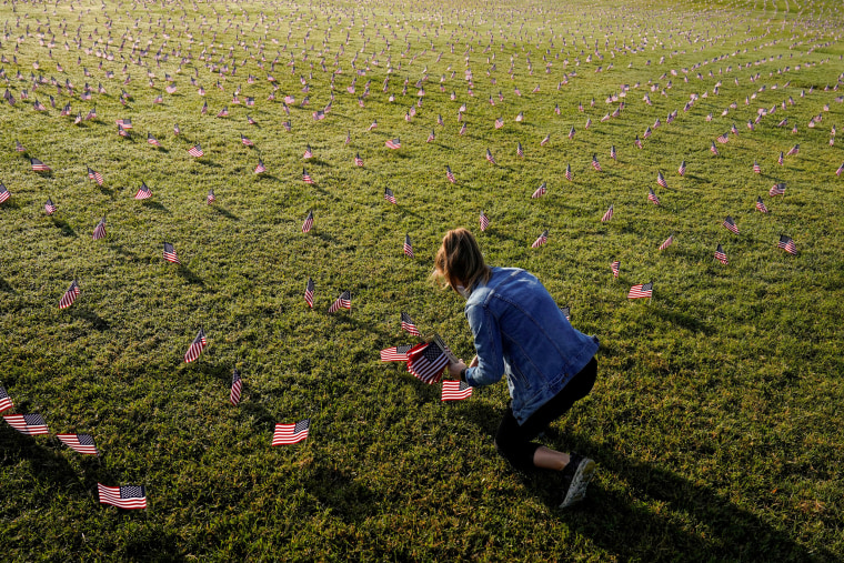 Image: American flags representing 200,000 lives lost due to coronavirus are placed on National Mall in Washington