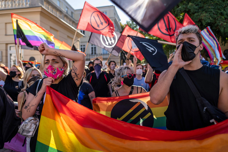 Image: Members of the LGBT community stage a protest during a counter demonstration against a demonstration of Polish nationalist, soccer hooligans and far right organisations members against the 'LGBT' rights movement in Warsaw