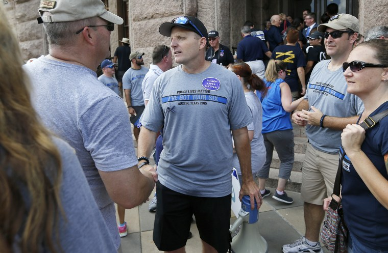 Police Lives Matter organizer Robert Chody thanks a rally supporter in Austin, Texas, on Sept. 19, 2015.
