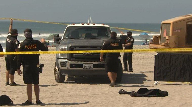 Police respond to a fatal beach accident in Oceanside, Calif., on Sept. 28, 2020.