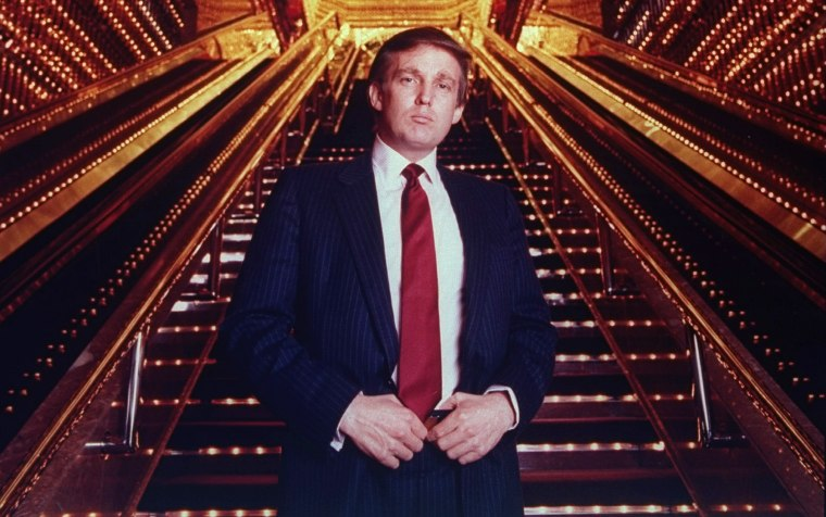 Image: Real estate tycoon Donald Trump poses in Trump Tower